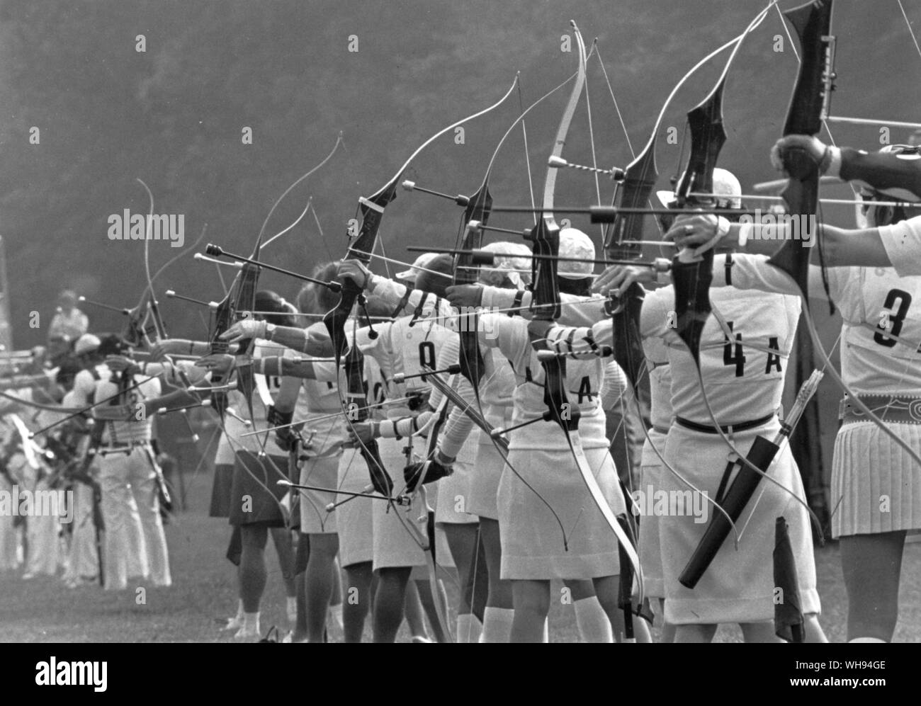 Competitors line up with bows strung at the start of the women's archery contest in Munich 7 September 1972. Archery returned to the Olympic scene for Stock Photo