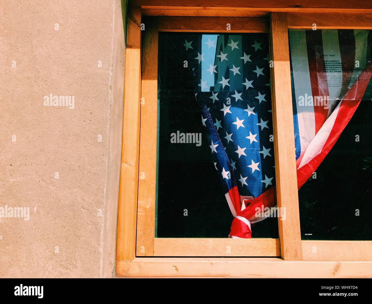 Low Angle View Of American Flag Curtain Seen From Window Glass Stock Photo