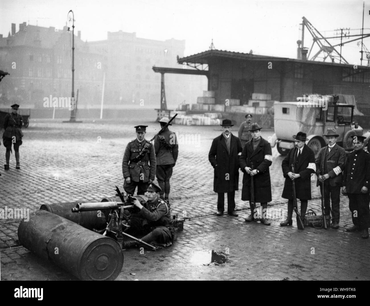 WW1/France: Machine gun sub-section attached to B Squadron. 18th Hussars, for duty at the harbour Cologne. Showing armed civilians who were policing the town. They were mostly ex-soldiers, 6th December, 1918. Stock Photo