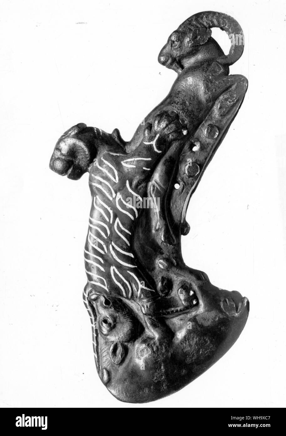 Persian ceremonian bronze axe head with silver inlay, from the Oxus treasure, 900-700 BC Stock Photo