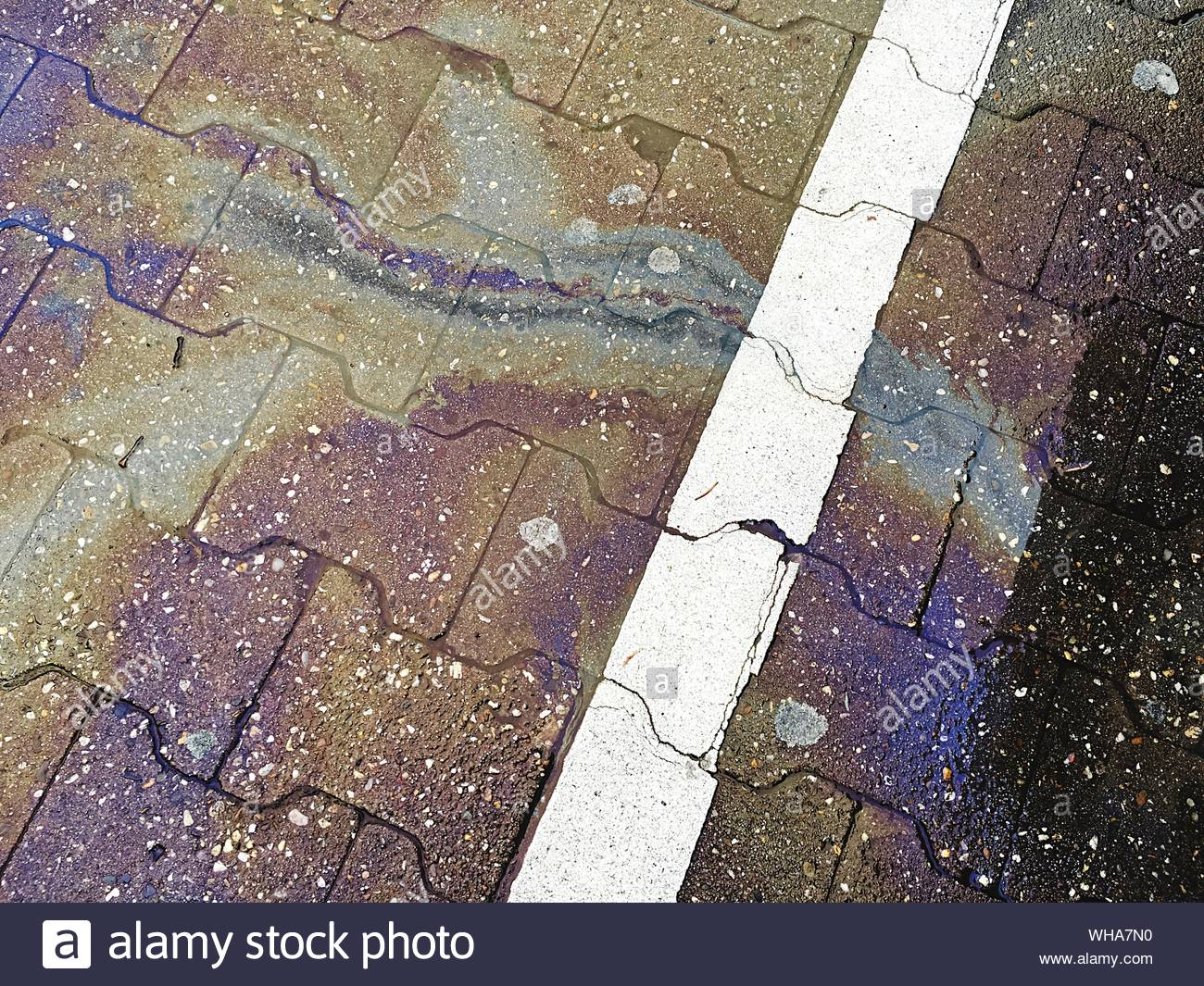 High Angle View Of Oil Spills On Street Stock Photo