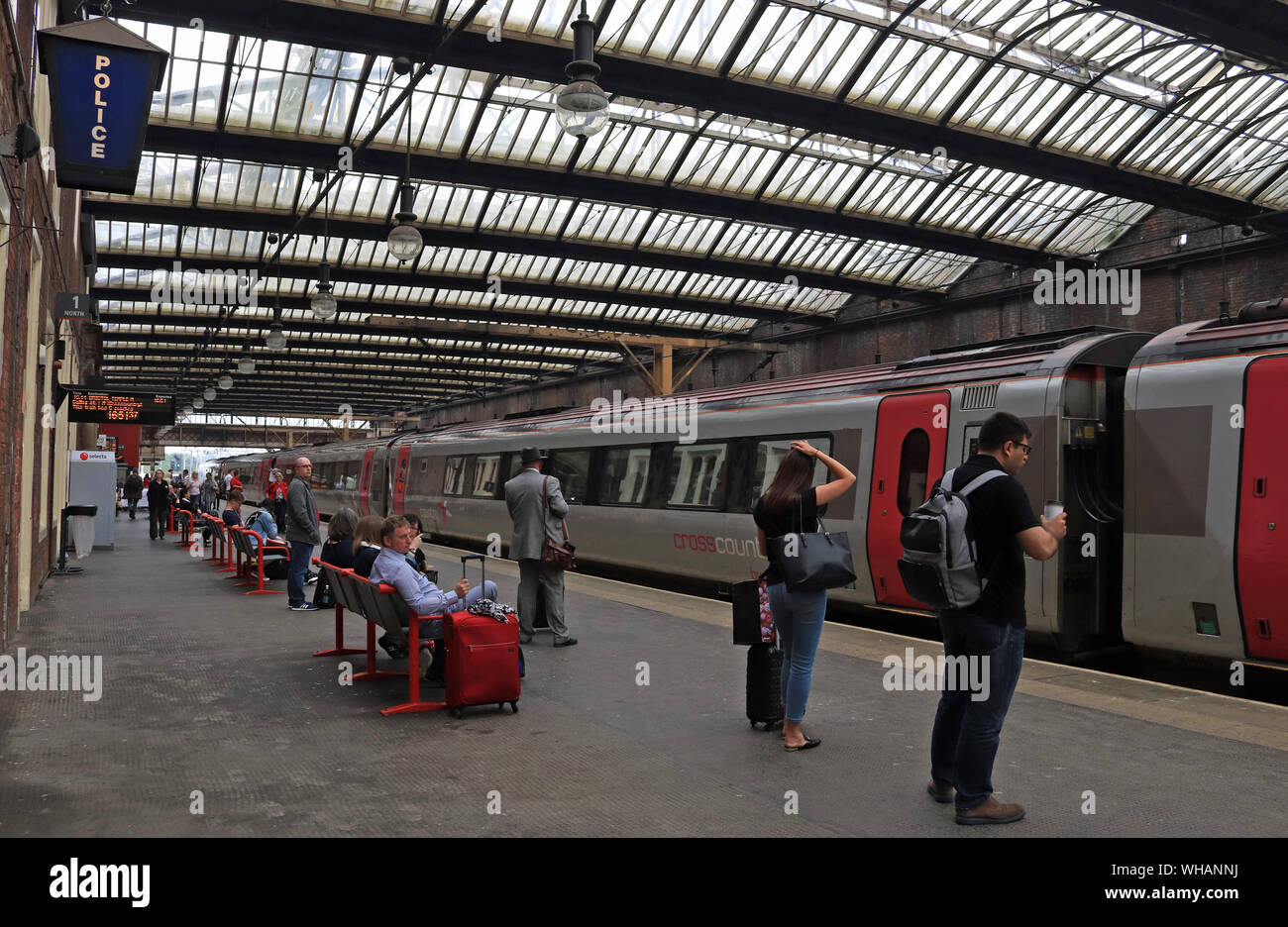 A Cross Country train arrives at Stoke on Trent railway station forming a service to Bristol Temple Meads as passengers wait to board. Stock Photo