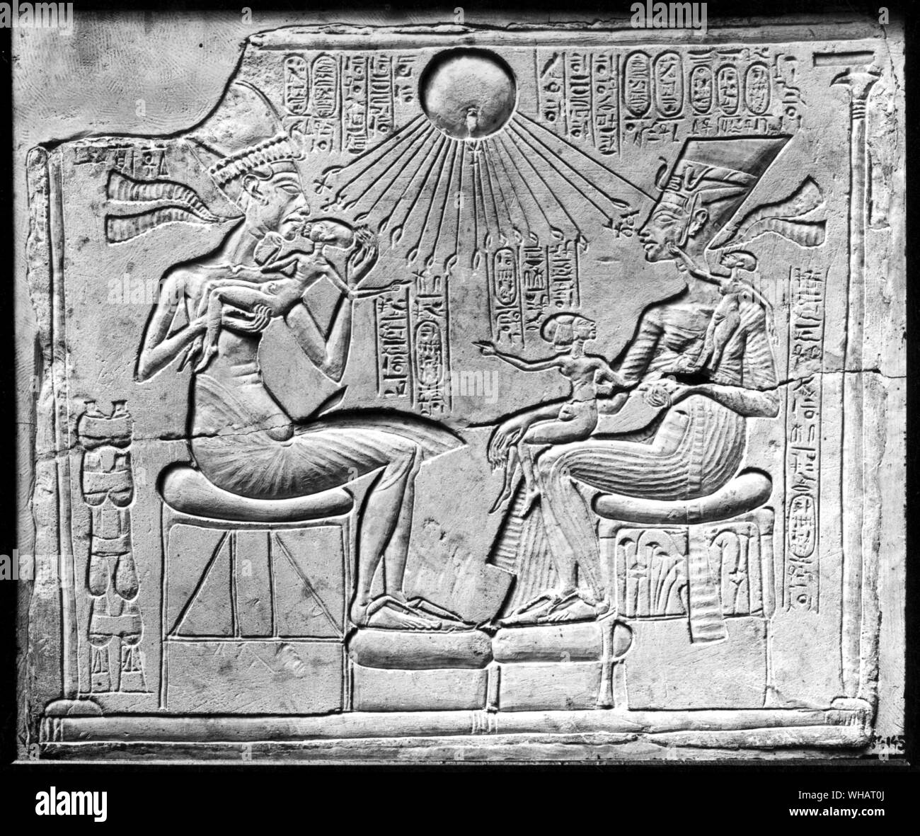Manifesto of the solar cult of Amarna. The sovereigns and the three princesses beneath the beneficial influence of the Globe. Limestone. Tutankhamen by Christiane Desroches Noblecourt, page 164.. Stock Photo