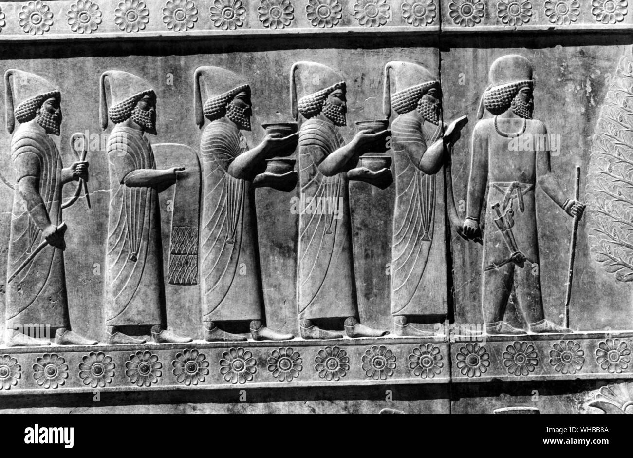 Apadana Palace Persepolis Persian Relief In Sculpture Of Officials Carrying Gifts Iran Stock Photo Alamy
