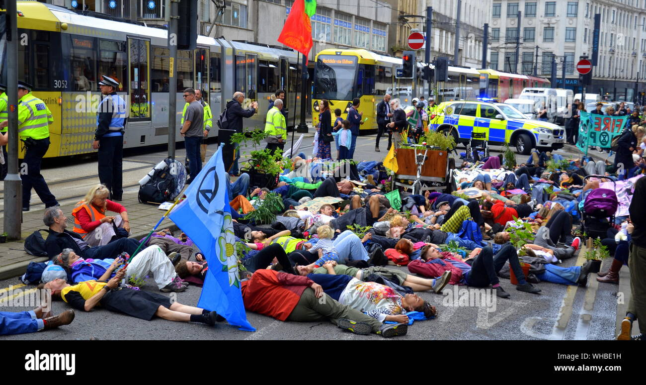 A die-in outside the Arndale Centre as Northern Rebellion protesters, part of the global movement Extinction Rebellion, marched through Manchester, uk, and held a series of die-ins to urge for action on climate change on September 2nd, 2019. Protest sites included Barclays Bank, a Primark store and HSBC Bank. This was the fourth day of a protest which blocked Deansgate, a main road in central Manchester. Stock Photo
