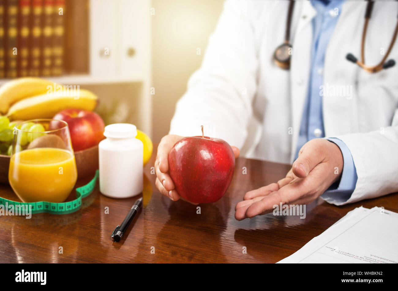 Nutritionist in office prefers healthy eating Stock Photo