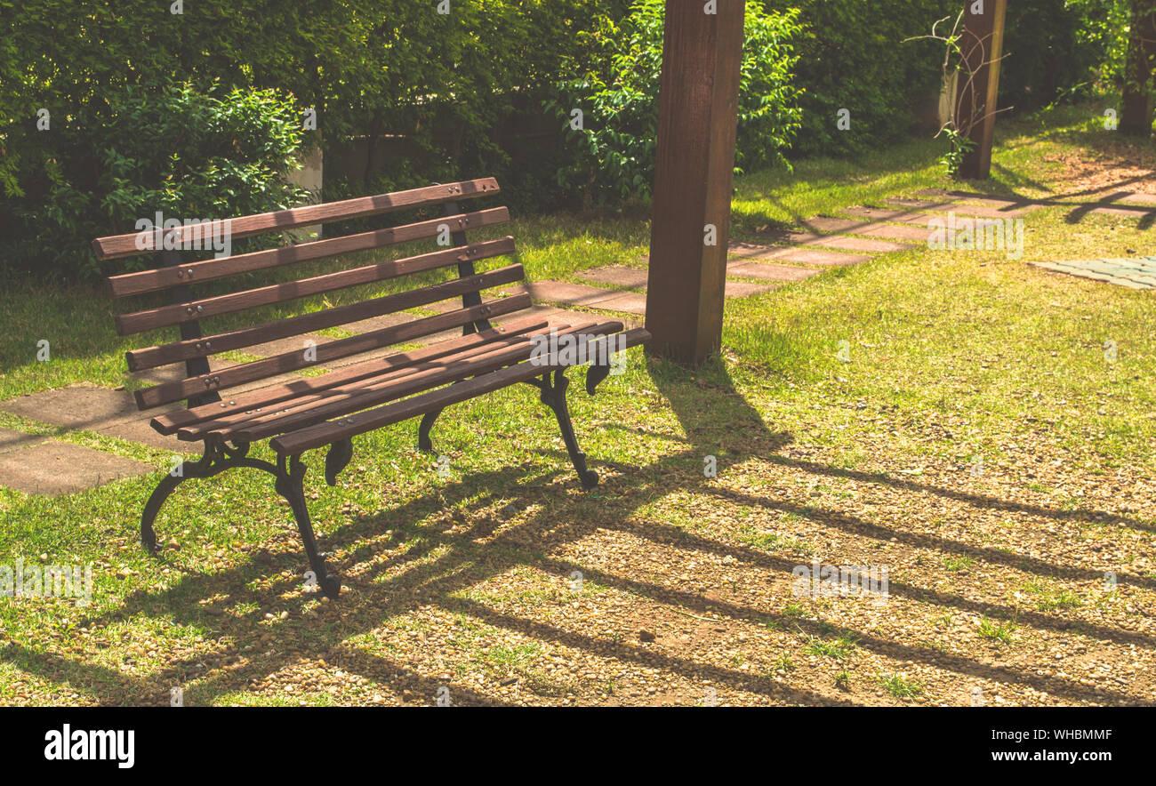 Empty Bench In Park Stock Photo