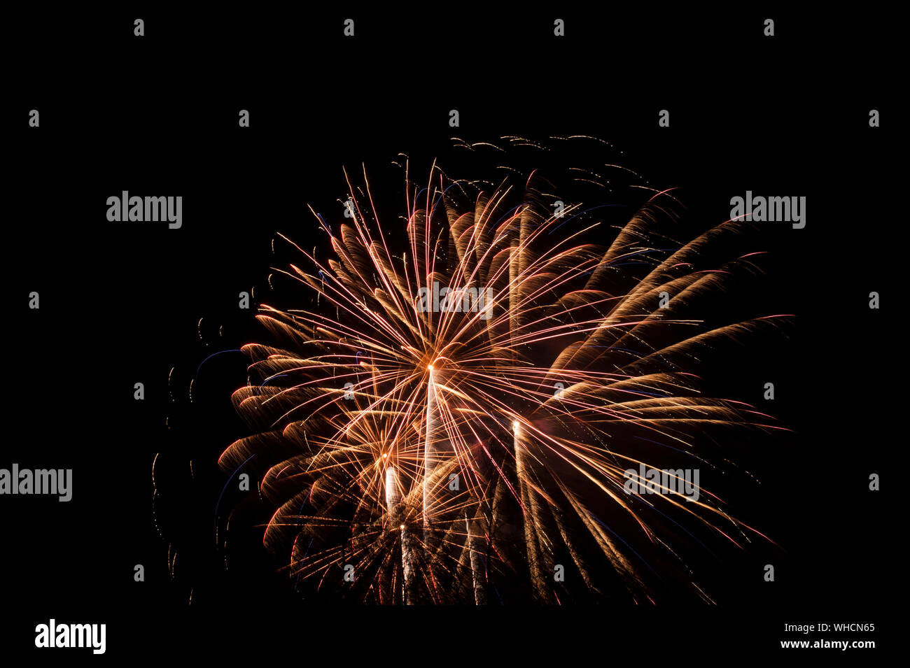 Low Angle View Of Firework Display Against Clear Sky At Night Stock Photo