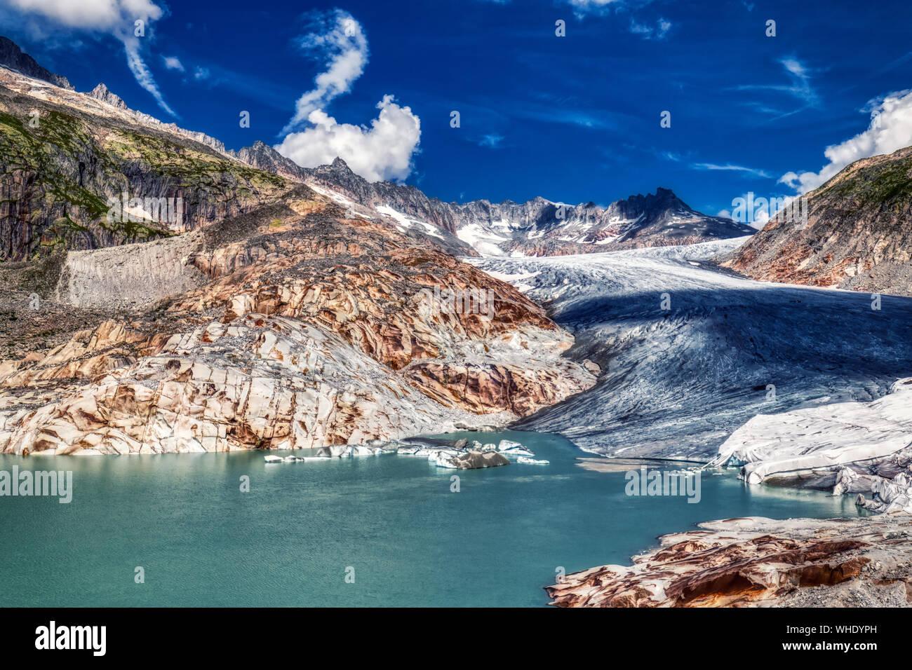 panorama of melting rhone glacier in swiss alps, switzerland Stock Photo