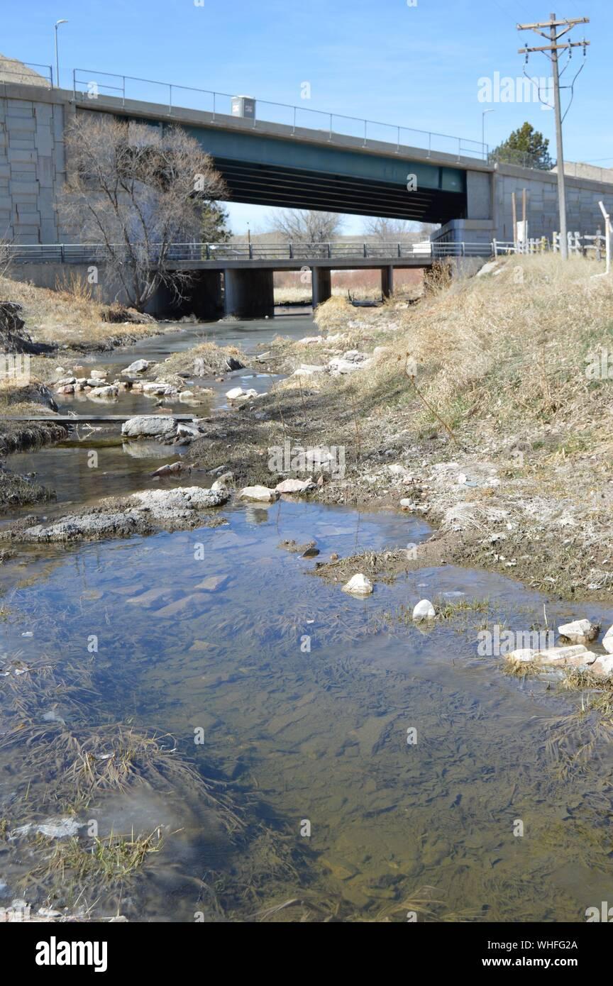 Stagnant Water Near Bridge Against Sky Stock Photo