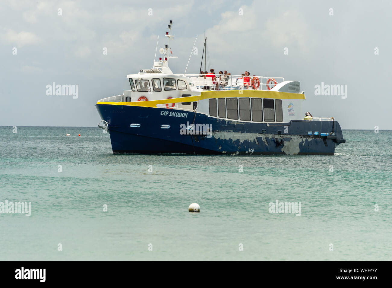 Anse-à-l'Âne, Martinique, France - 22 August 2019: Shuttle boat arriving at Anse-à-l'Âne. Stock Photo