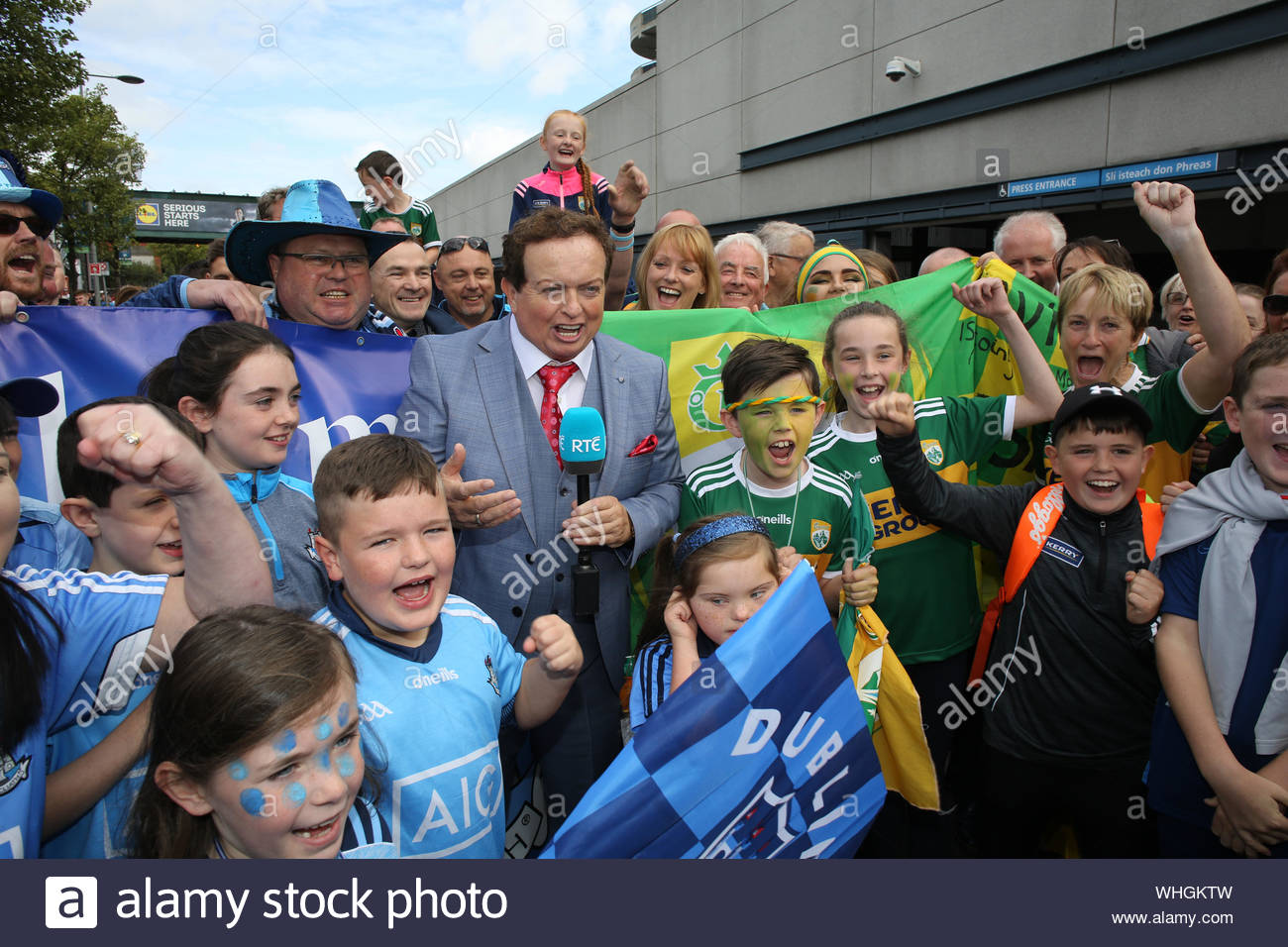 Dublin, Ireland September 1, 2019. RTE reporter Marty Morrissey with supporters of Dublin and Kerry at Croke Park in Dublin before an exciting All Ireland final game, which ended in a draw. The two teams will return on Saturday week with Dublin's hopes of five titles in a row still alive. Stock Photo