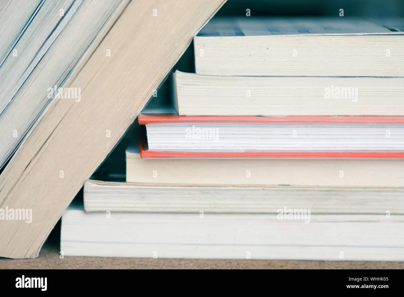 A large number of old books stacked on top of each other. Background shot, clean blank copy space Stock Photo