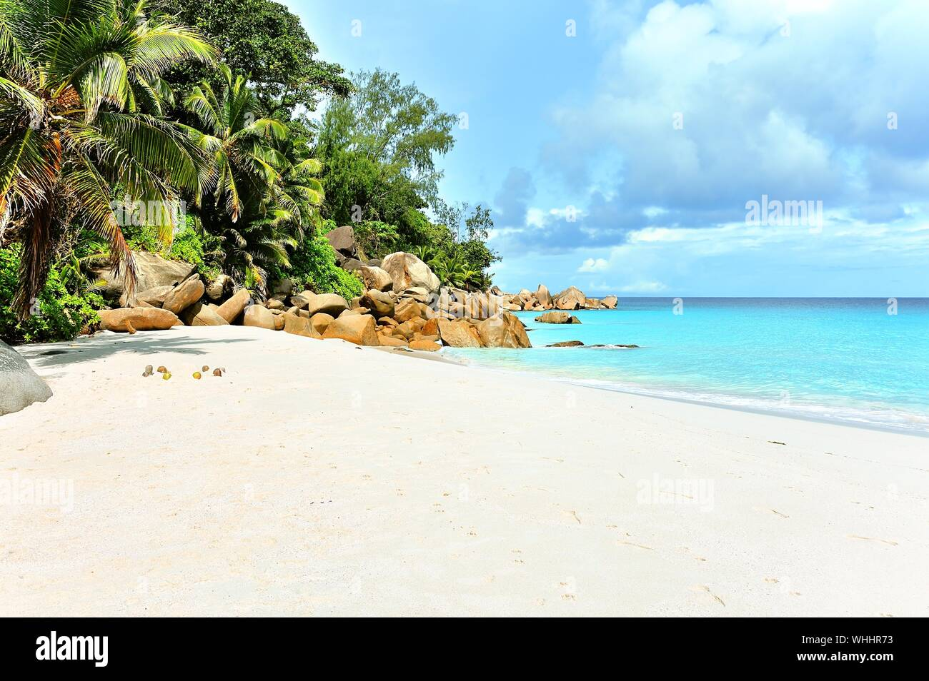 Scenic View Of Beach Against Cloudy Sky Stock Photo