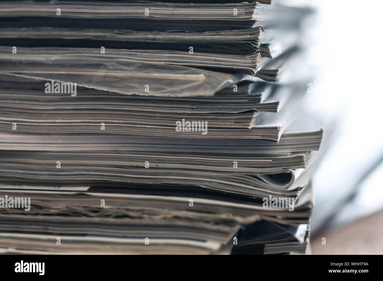 A stack of magazines, close-up macro filled the frame. A background for publishing or informational articles. Stock Photo