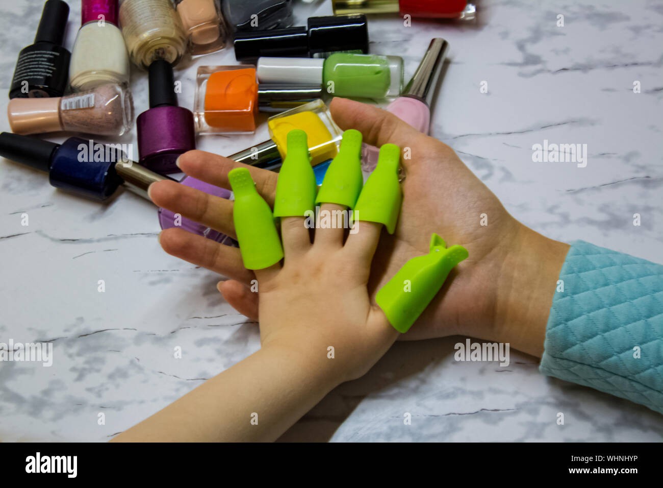 Children S Manicure Children S Beauty Salon Paint Your Child S Nails With Nail Polish Nail Polish Remover Clips On The Girl S Fingers Stock Photo Alamy