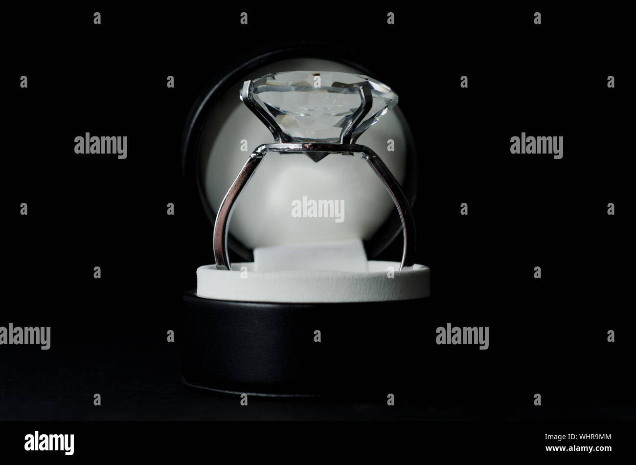 Close-up Of Diamond Ring Over Black Background Stock Photo