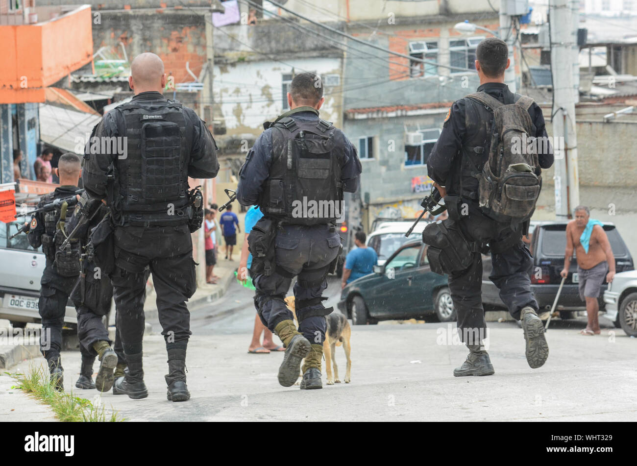 RIO DE JANEIRO, BRAZIL, MARCH, 21, 2015: Rio de Janeiro military police with snipers patrolling the German complex, slum complex Stock Photo