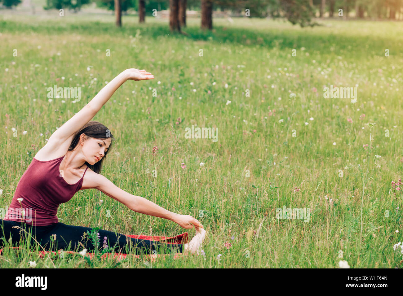 Yoga And Meditation In Nature On A Sunny Day Beautiful Woman In Burgundy Top On The Background Of Fields And Forests Copy Space Stock Photo Alamy