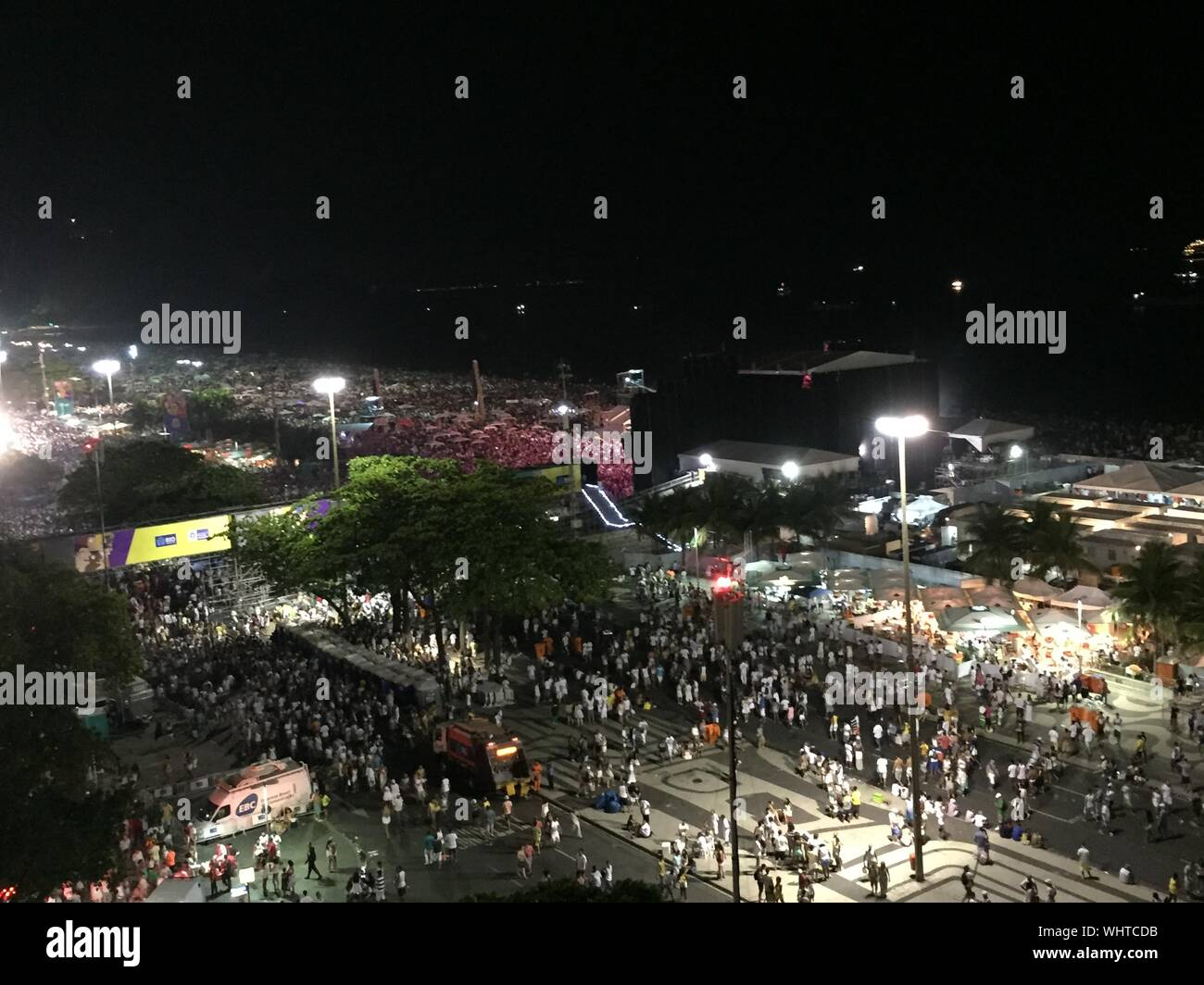 High Angle View Of Crowd Gathered On Street At Night Stock Photo