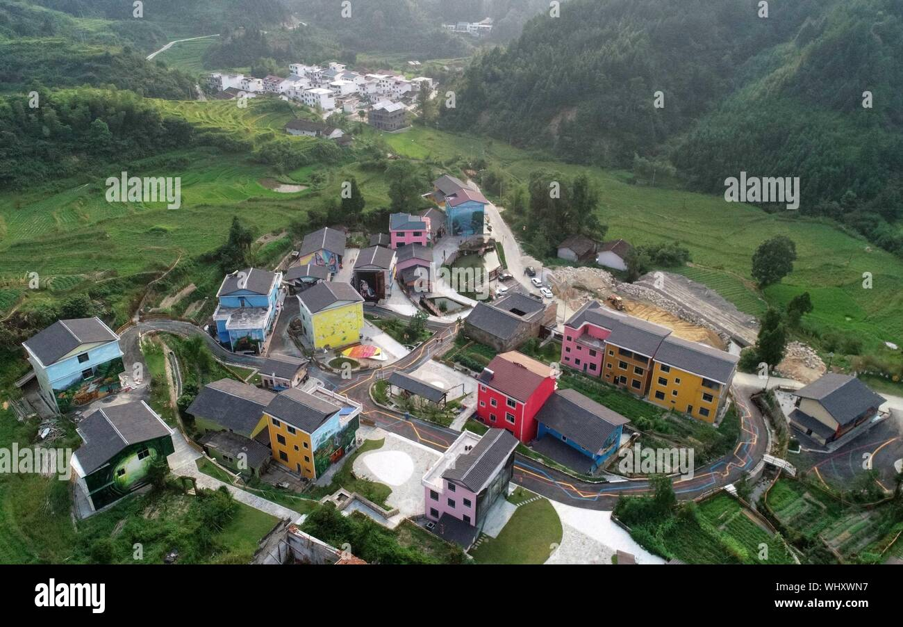 Beijing, China. 21st Aug, 2019. Aerial photo taken on Aug. 21, 2019 shows the view of Datong Village in Jinzhu She Ethnic Group Township in Le'an County, east China's Jiangxi Province. China has adopted the vision that lucid waters and lush mountains are invaluable assets and pursued a holistic approach to conserving its mountains, rivers, forests, farmlands, lakes, and grasslands. At the very highest levels, China is driving the way forward in the construction of an ecological civilization. Credit: Peng Zhaozhi/Xinhua/Alamy Live News Stock Photo