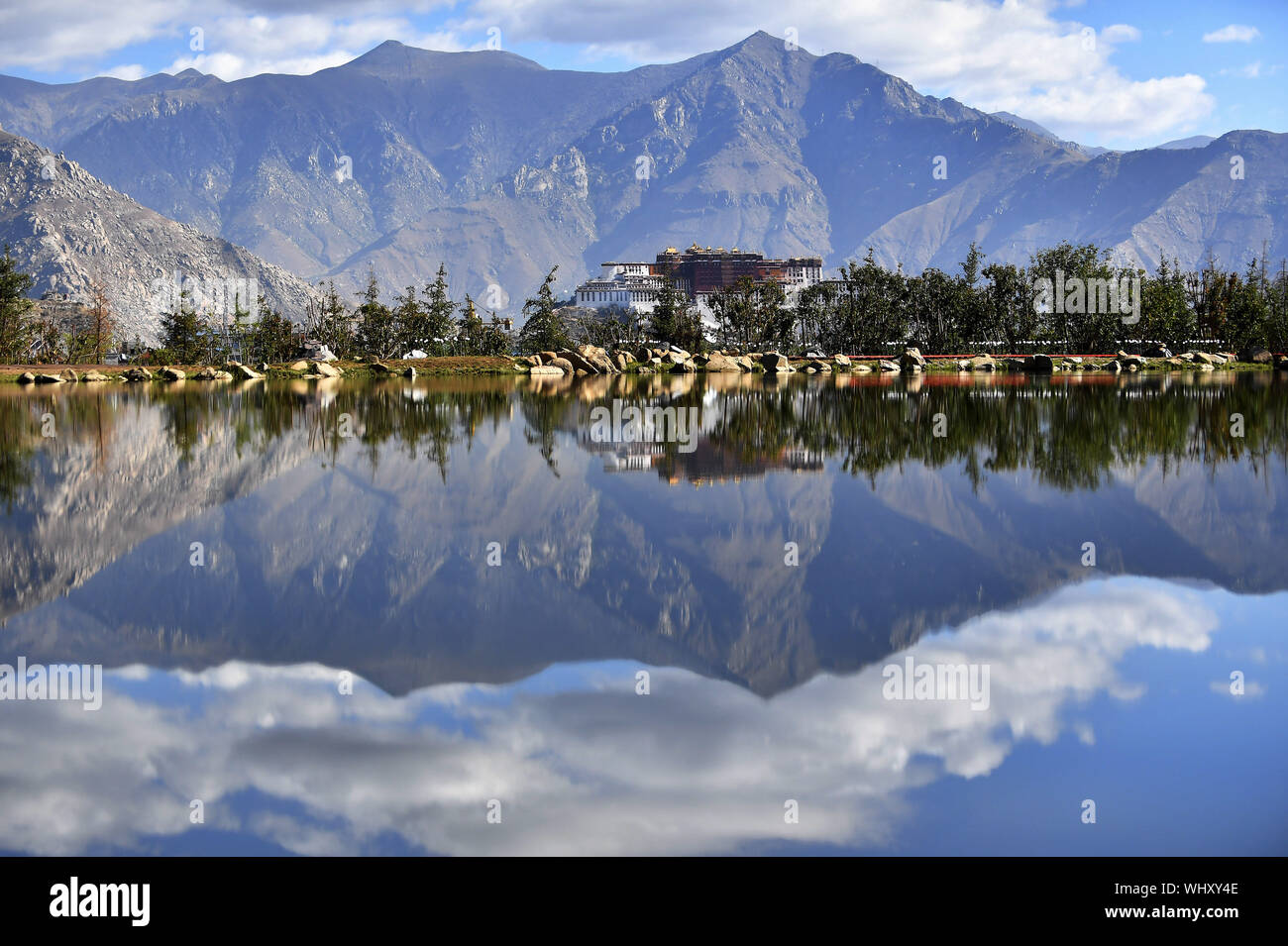 (190903) -- BEIJING, Sept. 3, 2019 (Xinhua) -- Photo taken on June 5, 2019 shows scenery of the Potala Palace in Lhasa, capital of southwest China's Tibet Autonomous Region. China has adopted the vision that lucid waters and lush mountains are invaluable assets and pursued a holistic approach to conserving its mountains, rivers, forests, farmlands, lakes, and grasslands. At the very highest levels, China is driving the way forward in the construction of an ecological civilization. (Xinhua/Chogo) Stock Photo