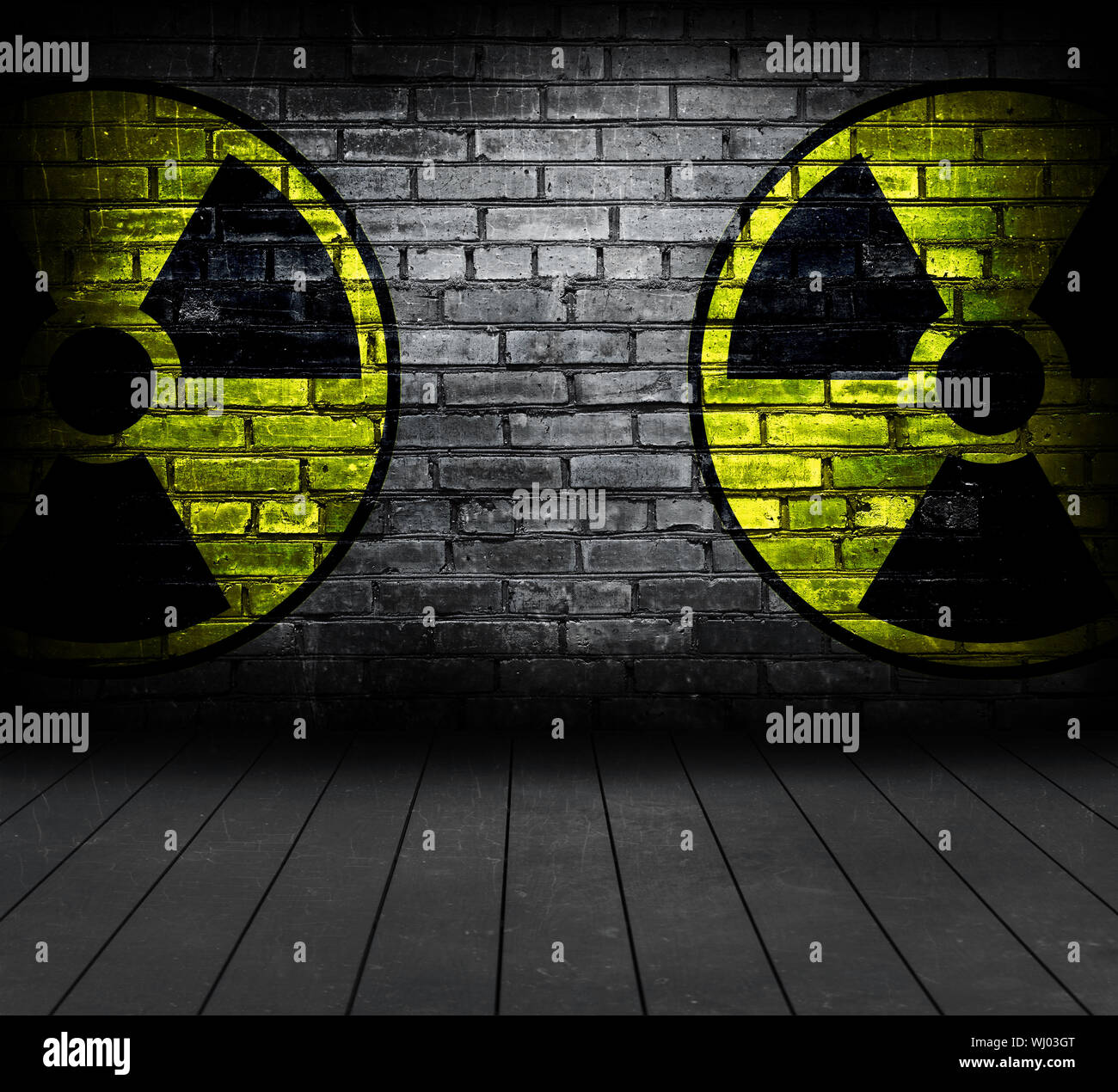 Radiation sign on a brick wall. - Stock Photo