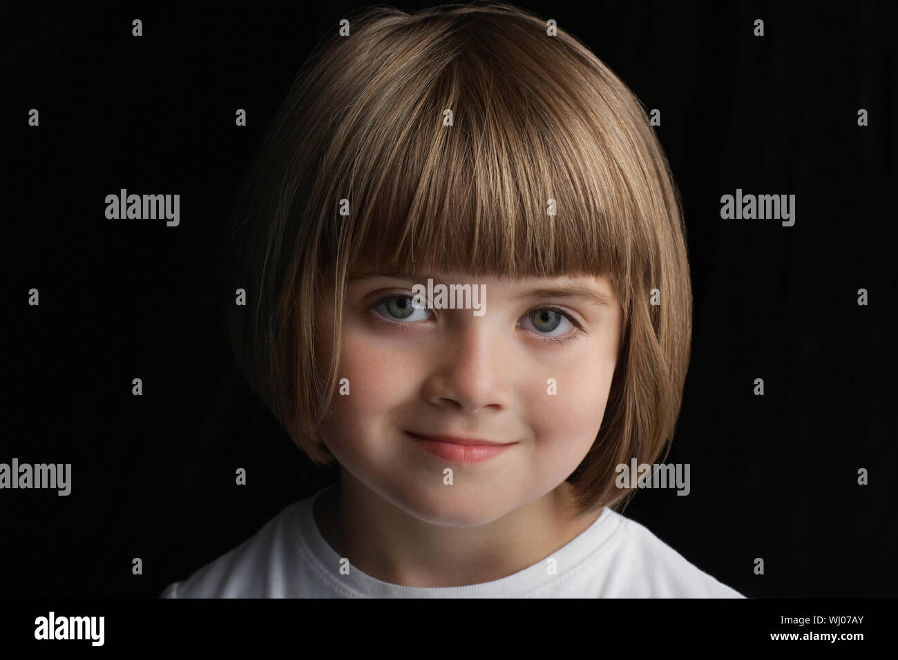 Closeup Portrait Of Happy Cute Little Girl With Short Hair Isolated On Black Background Stock Photo Alamy