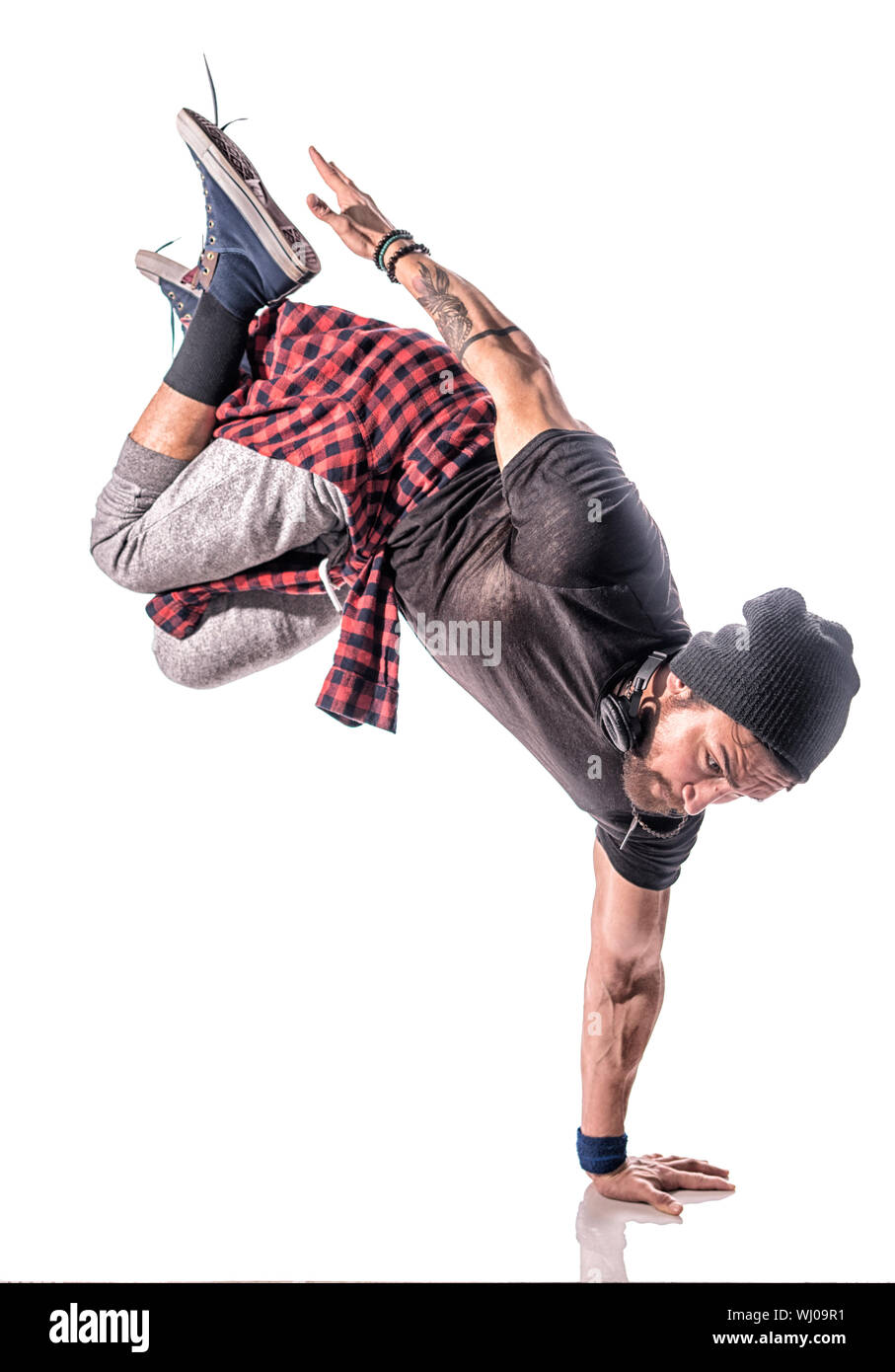 Hip-hop Dancer Doing Handstand Against White Background Stock Photo