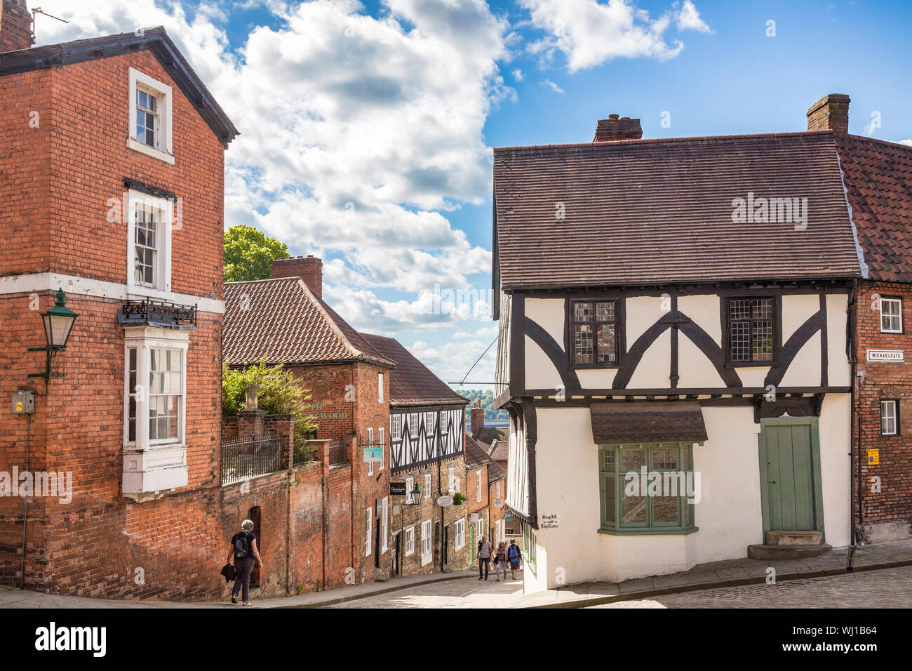 2 July 2019: Lincoln, UK - Tourists near the top of Steep Hill, Lincoln, UK, on a beautiful summer day. Stock Photo
