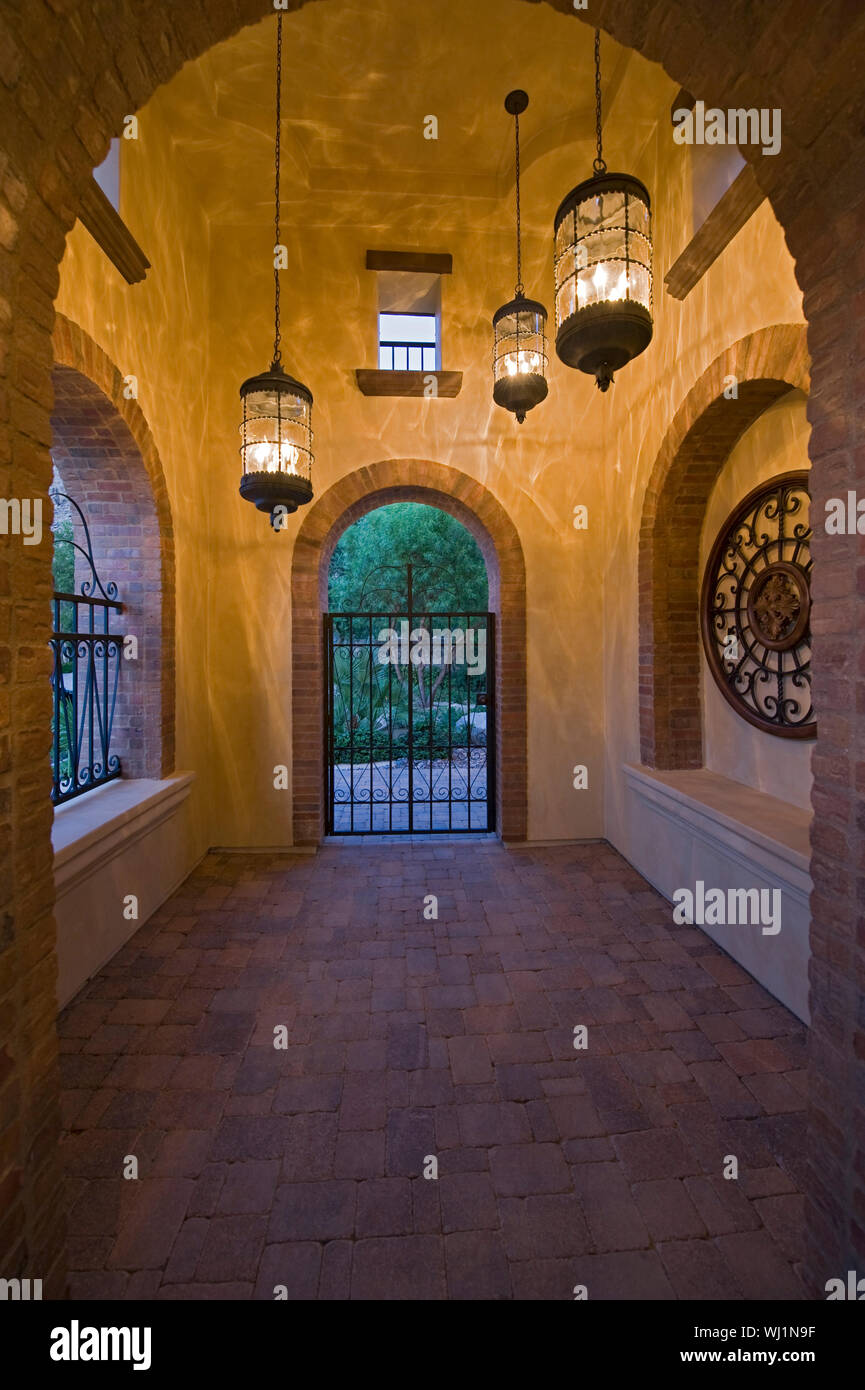 Arched hallway with lit hanging lights in modern home Stock Photo