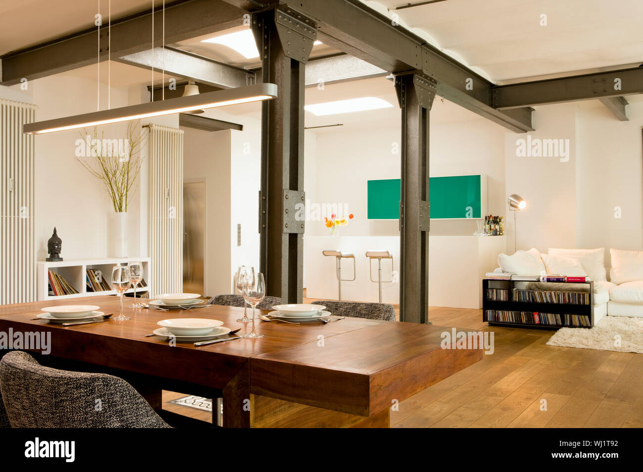 Dining Room With View Of Bar And Living Area In The Background At Modern Home Stock Photo Alamy