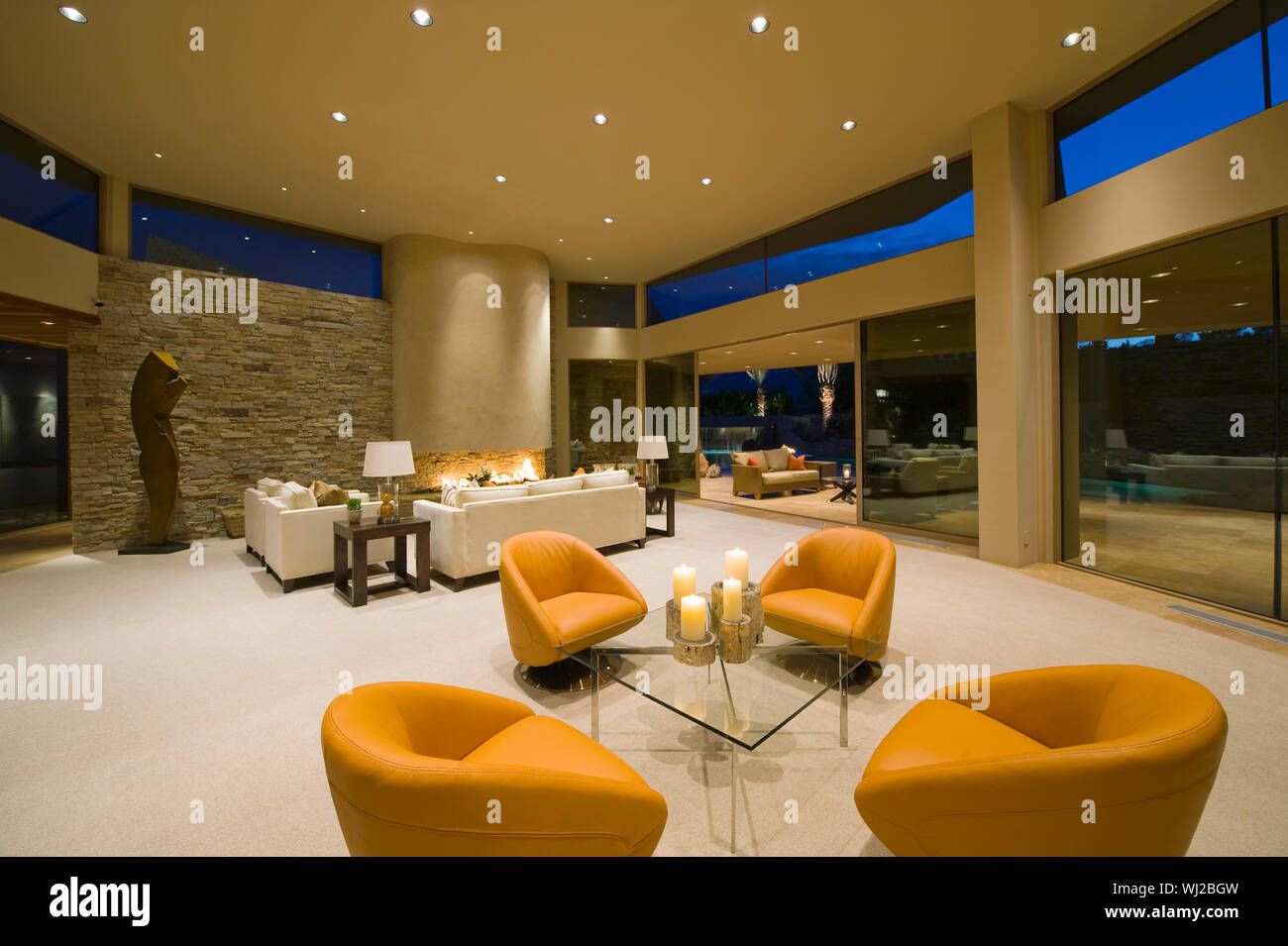 Modern armchairs in spacious living room with view of ...