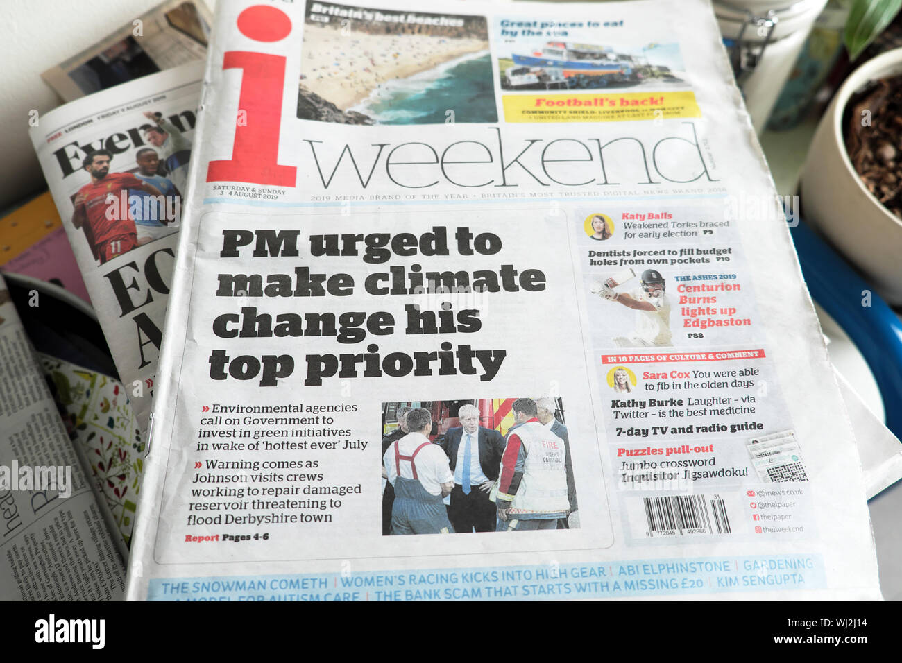 """Boris Johnson """"PM urged to make climate change his top priority"""" front page i weekend newspaper headline 3 - 4 August 2019 London England UK Stock Photo"""