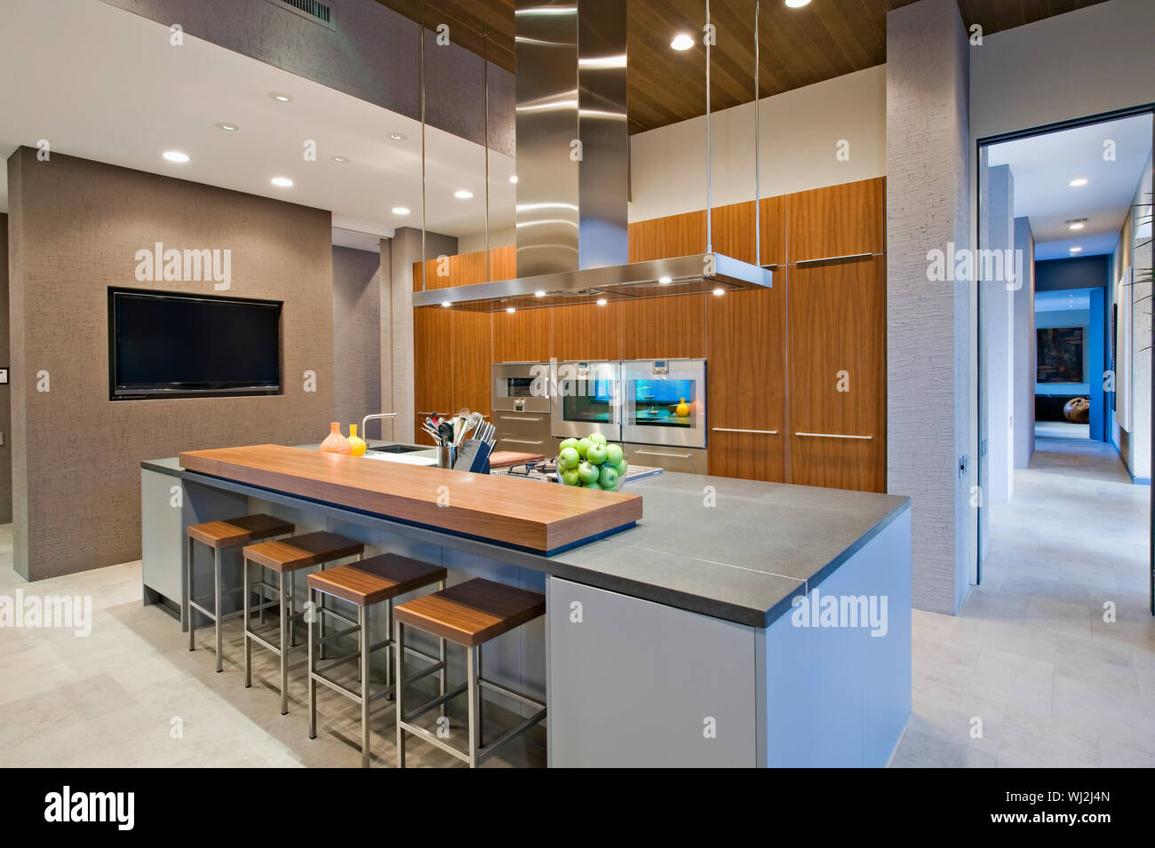 Bar stools at breakfast bar in contemporary kitchen Stock ...
