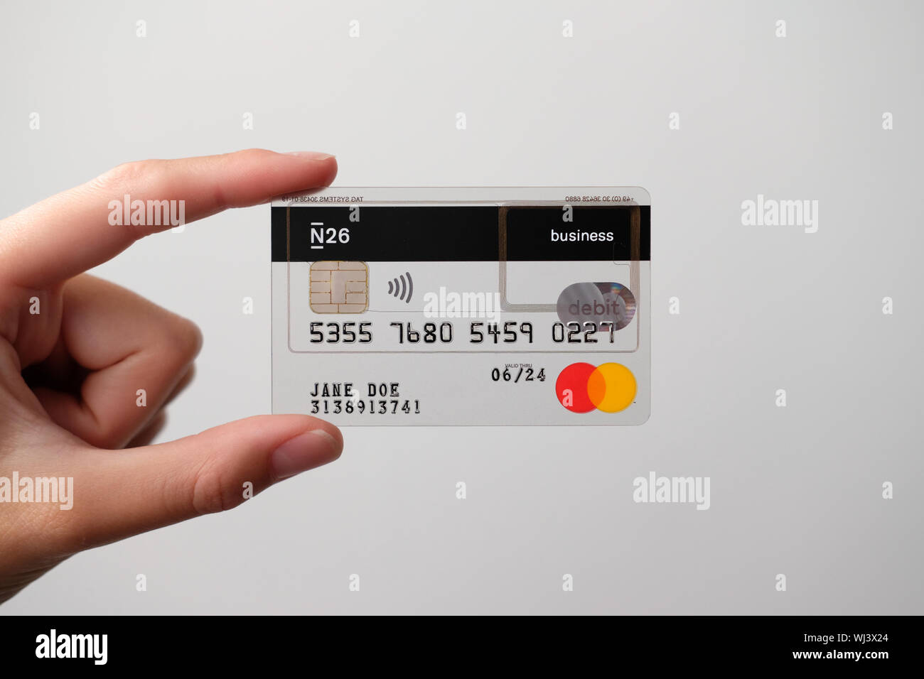 N26 transparent business creditcard held straight by female hand Stock Photo