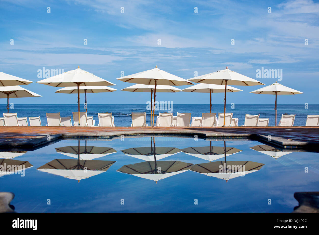 Outstanding White Beach Umbrellas And Lounge Chairs At Sunny Ocean Ncnpc Chair Design For Home Ncnpcorg