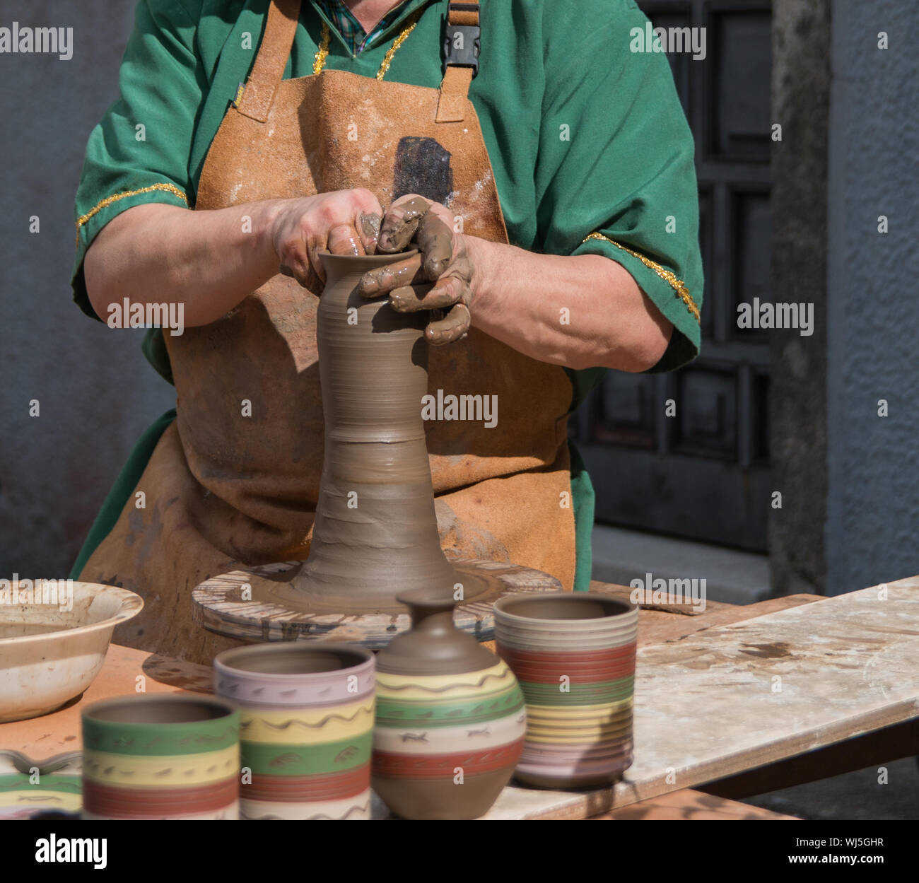 Potter working the mud with his hands Stock Photo