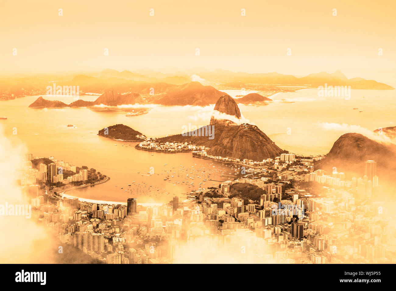 Rio de Janeiro, Brazil. Suggar Loaf and  Botafogo beach viewed from Corcovado at sunrise. Stock Photo