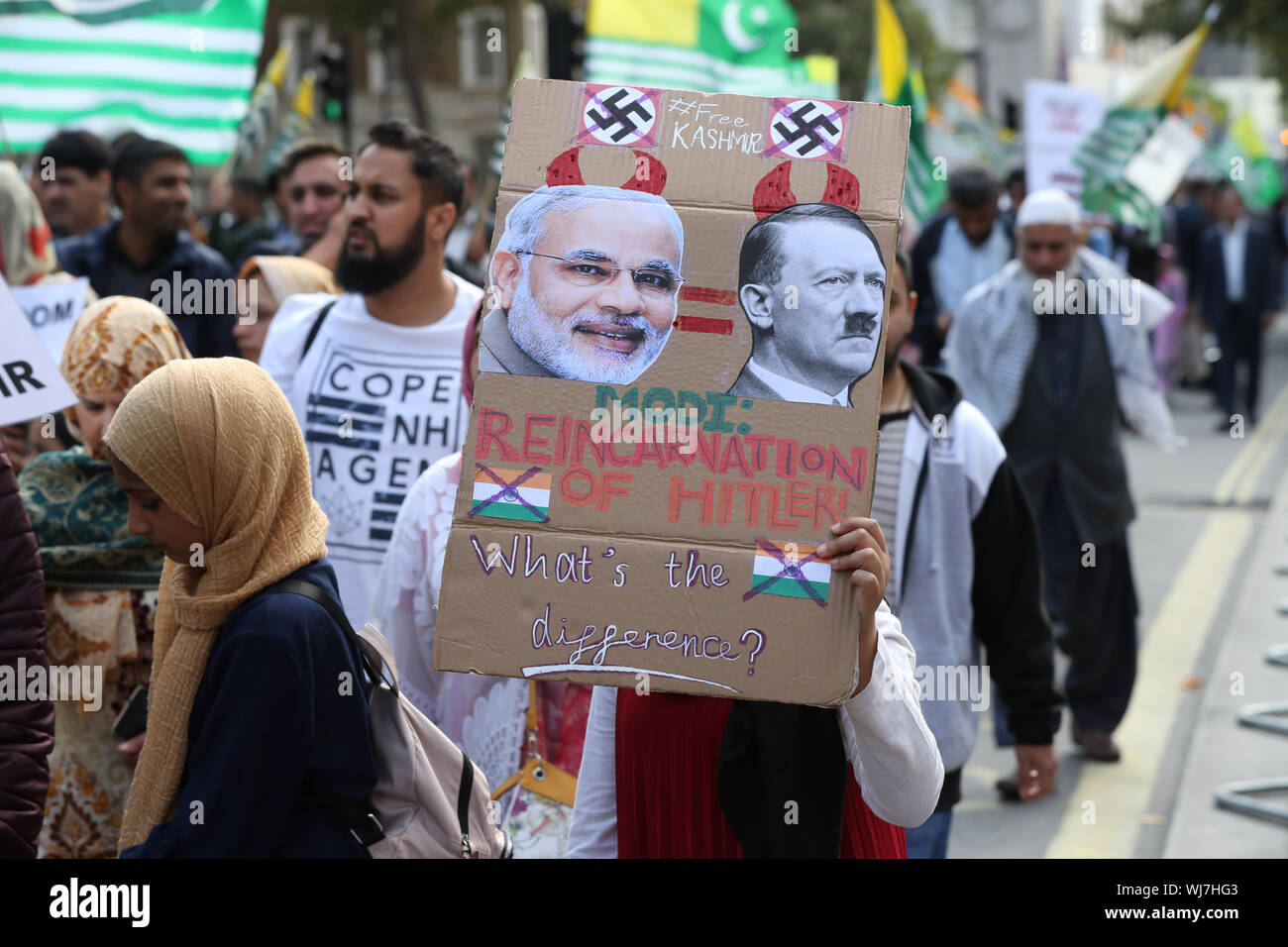 Pro-Kashmiri independence campaigners walk along Whitehall in London, over the issue of India revoking a Article 370, a law which had given the disputed state of Kashmir semi independence via a certain amount of autonomy. Stock Photo