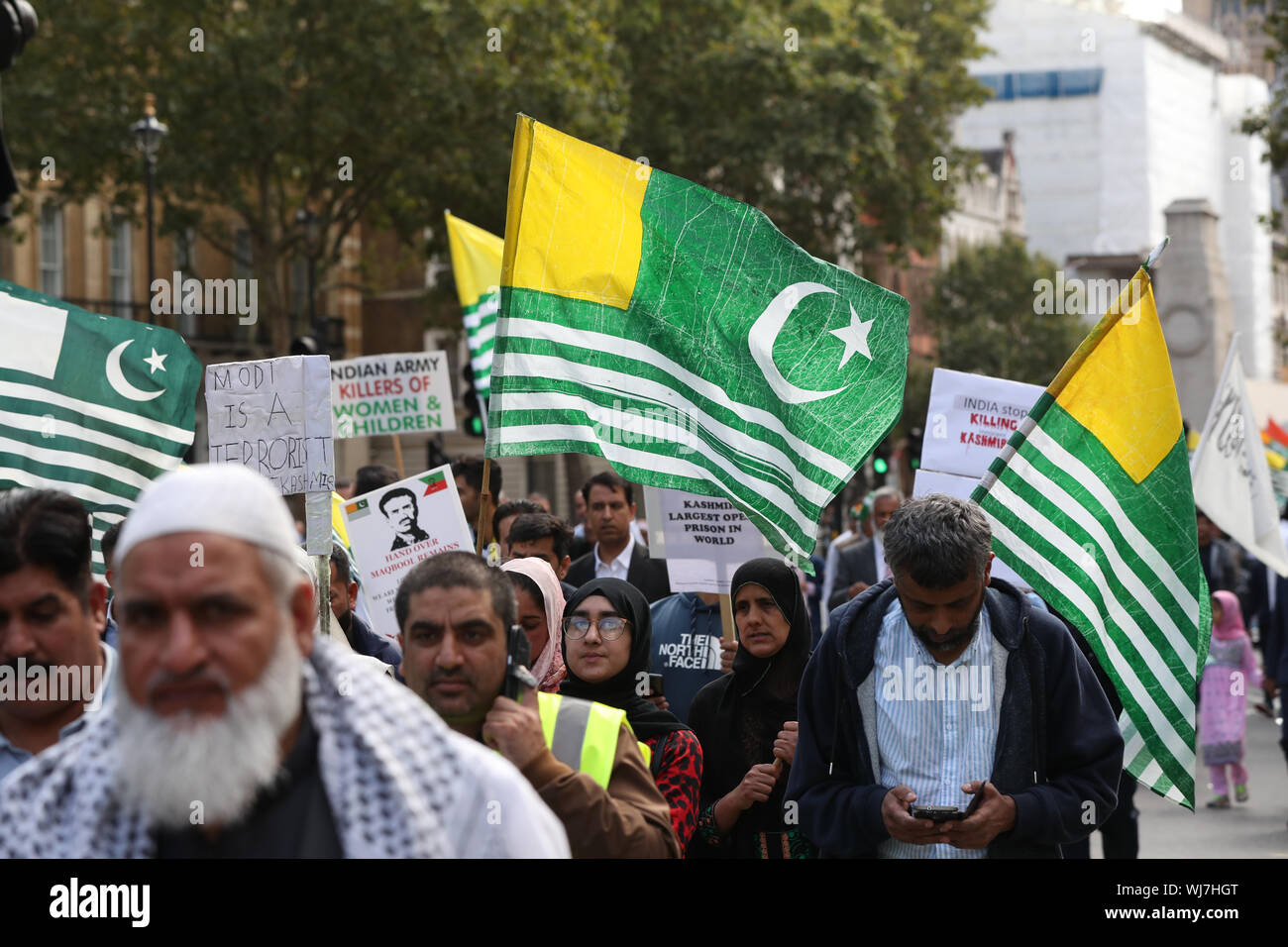 Pro-Kashmiri independence campaigners walk along Whitehall in London, over the issue of India revoking a Article 370, a law which had given the disputed state of Kashmir semi independence via a certain amount of autonomy. - Stock Photo