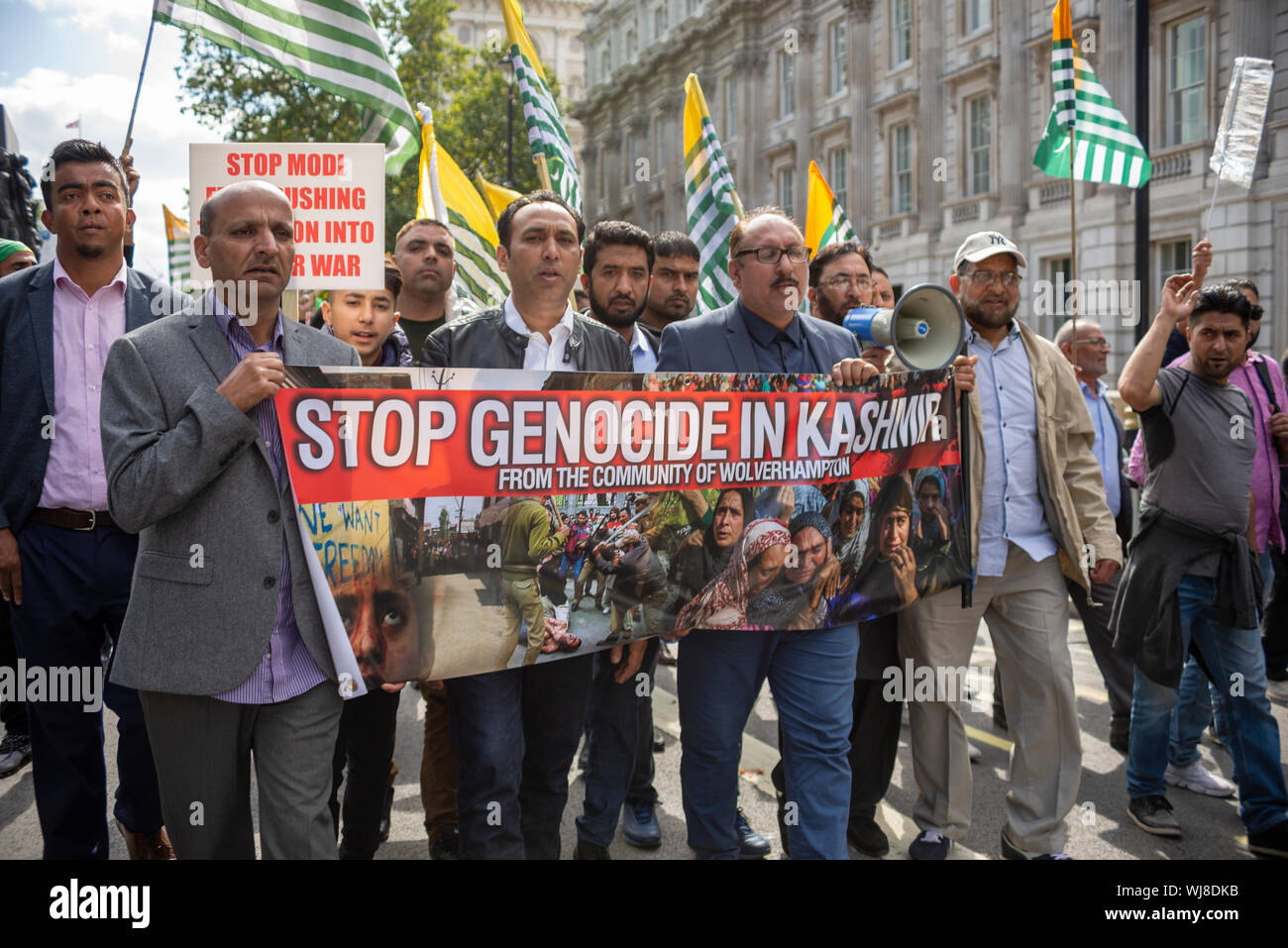 A protest is taking place in Westminster, London, UK demonstrating against the Indian occupation of Jammu and Kashmir, claiming that thousands have been killed and injured by the Indian armed forces. On 5th August Article 370 – which protected the rights of the population of the area – was revoked by the BJP government Stock Photo