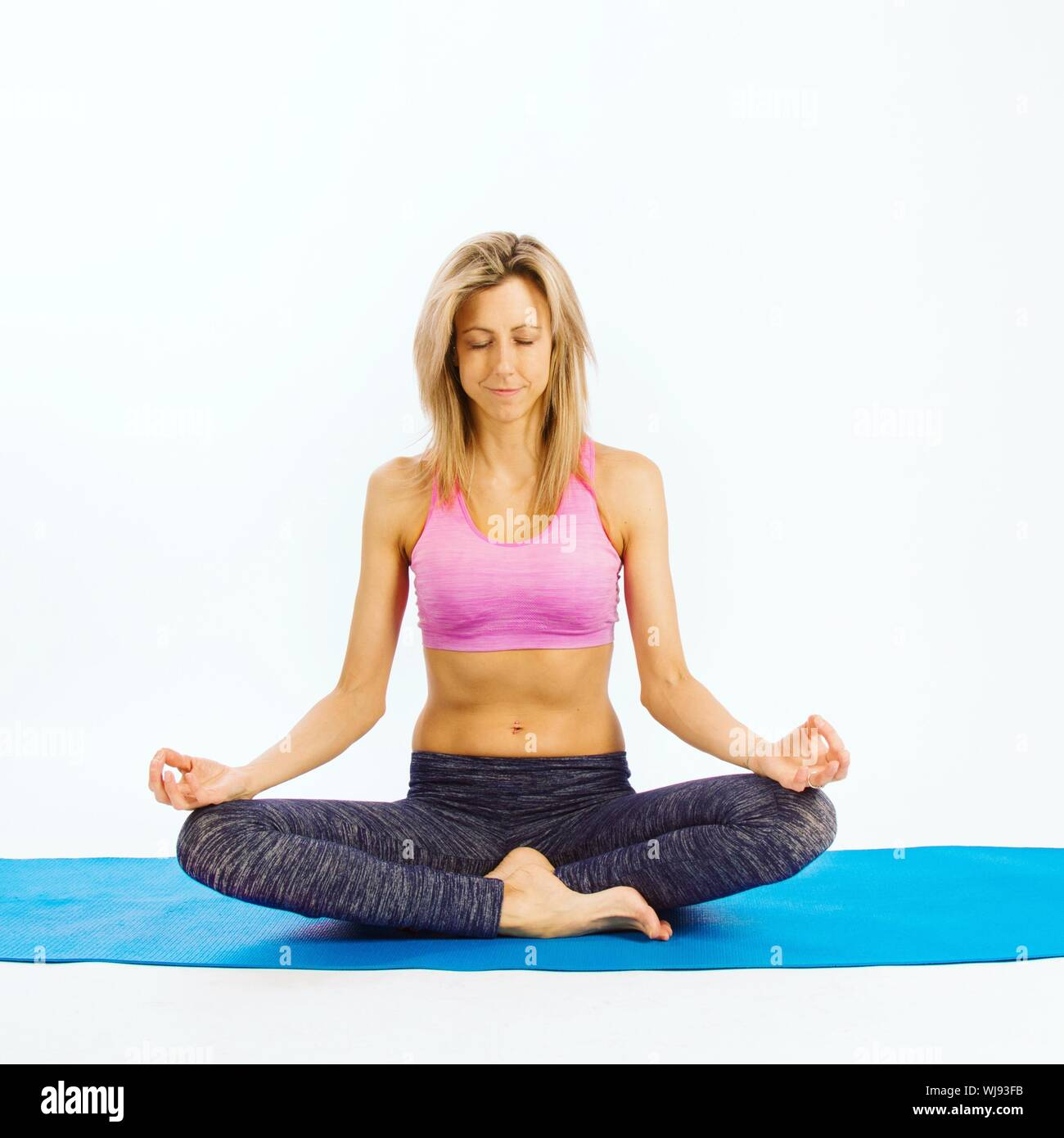 Beautiful Woman Practicing Lotus Position On Yoga Mat Against White Background Stock Photo Alamy