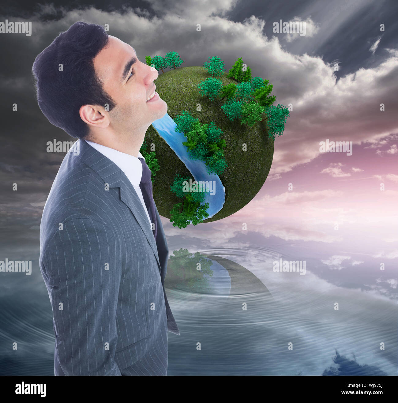 Composite image of smiling businessman standing Stock Photo
