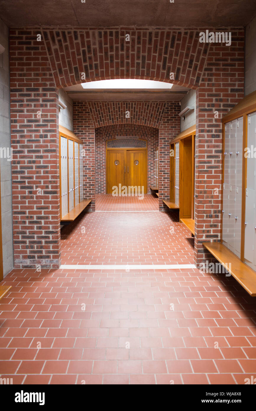 View Of An Empty Brick Walled Corridor With Tiled Flooring In College Stock Photo Alamy