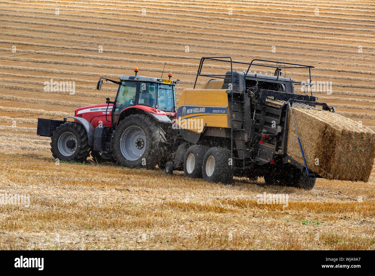 Hay Baler - farm machinery used to compress a cut and raked