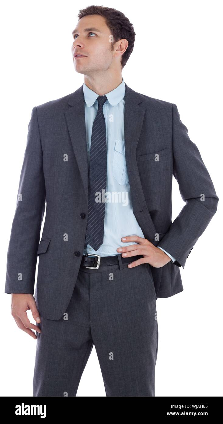 Serious businessman with hand on hip - Stock Photo