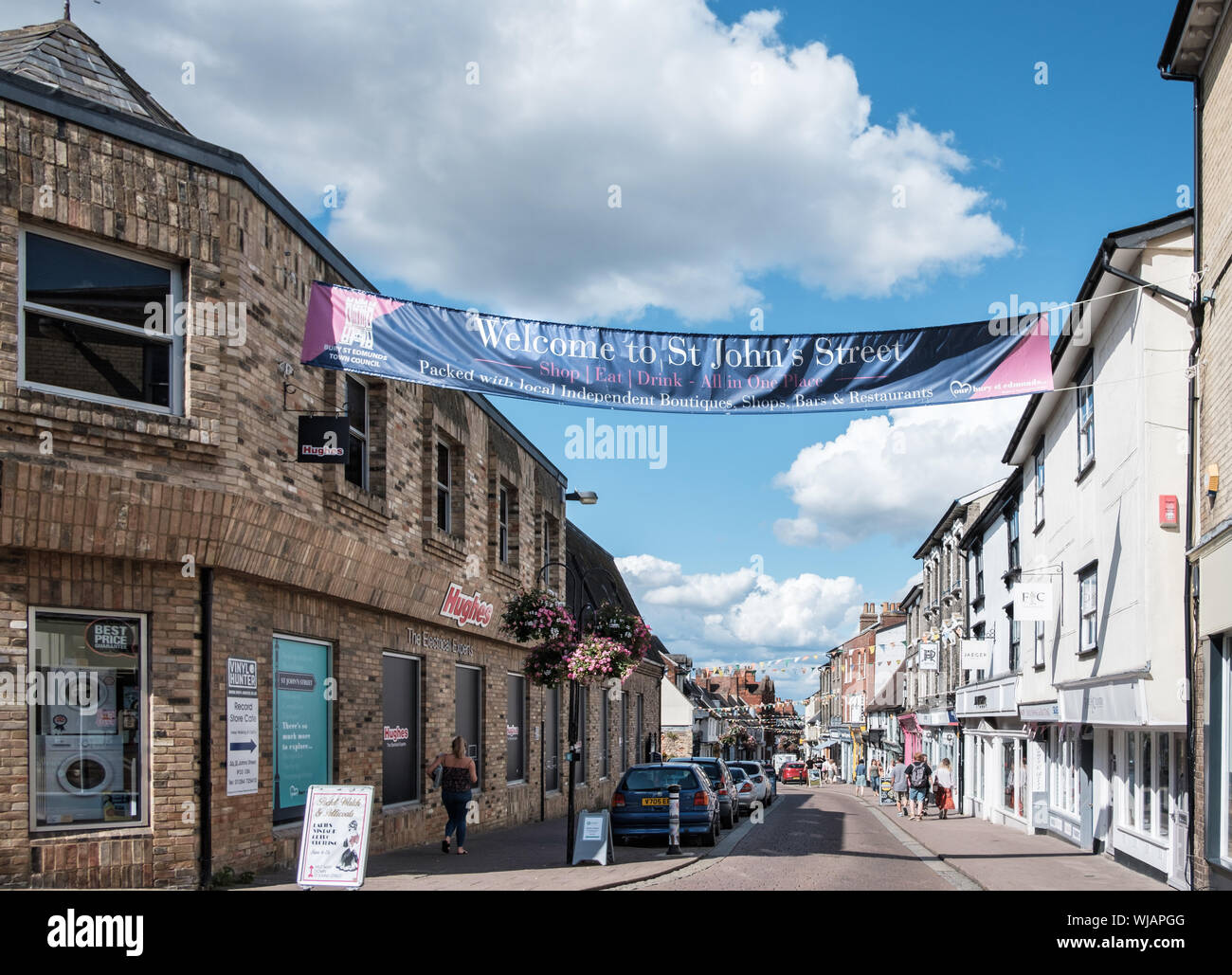 A banner welcomes shoppers to St John's Street, known for independent shops, boutiques and restaurants, Bury St Edmunds, Suffolk Stock Photo