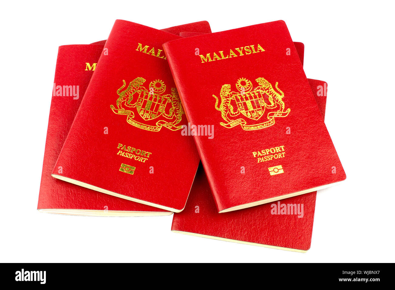 A stack of Malaysian passports isolated on a white background Stock Photo