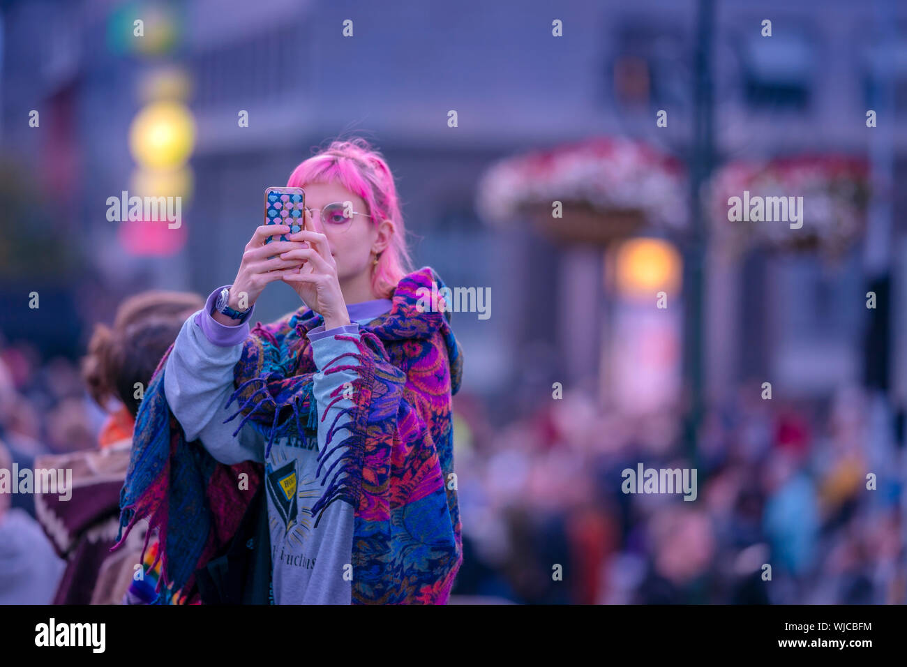 Girl taking a picture with a smart phone, Menningarnott or Cultural day, Reykjavik, Iceland. Stock Photo